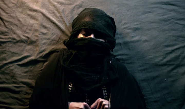 """A still from """"Fade to Black,"""" a film by Amer Albarzawi and Farah Presley."""